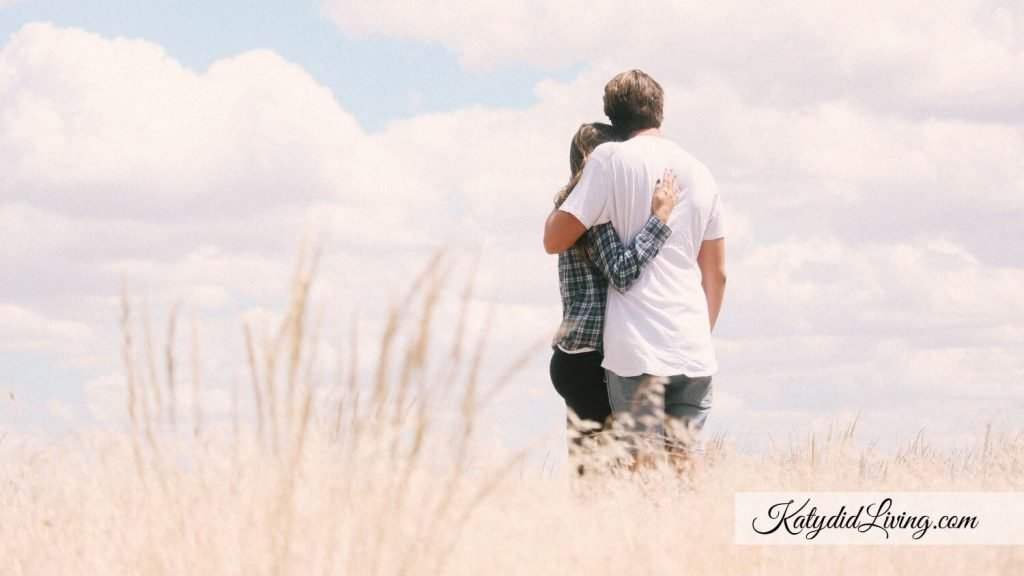 IVF Cycle Cancelled What to do Next - Couple hugging in field