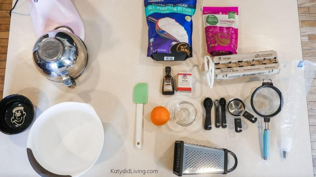 How to make Ladyfingers - ingredients and equipment arranged on counter.