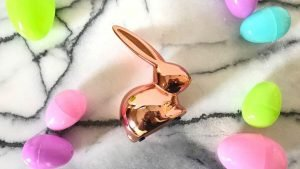 Easter Dinner Recipes. Rose gold bunny surrounded by neon Easter eggs.