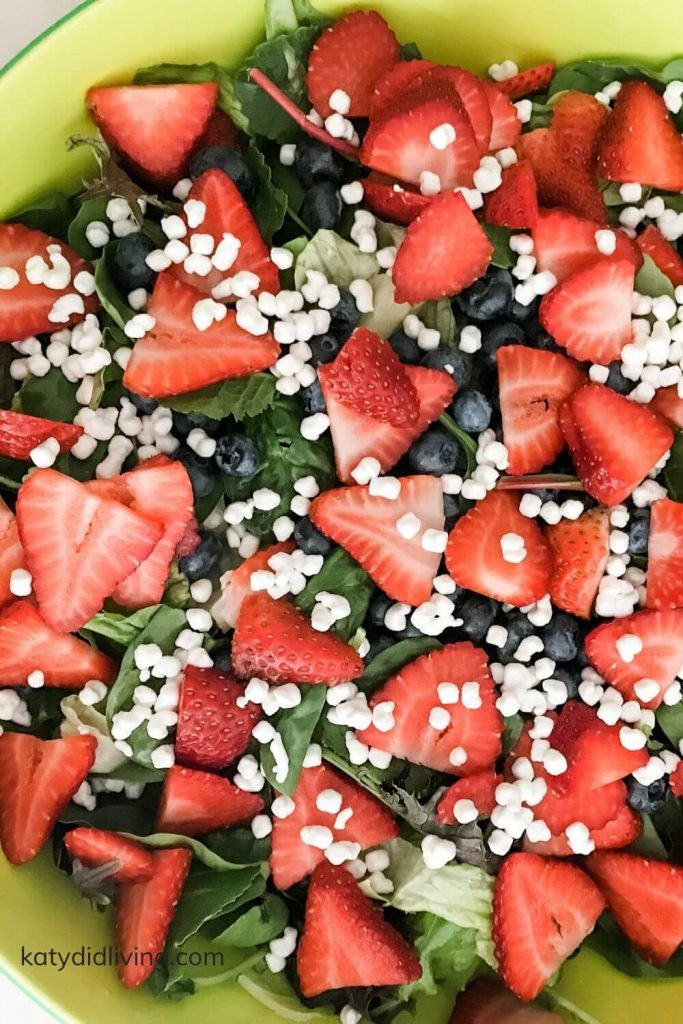 Salad with berries and goat cheese crumbles.