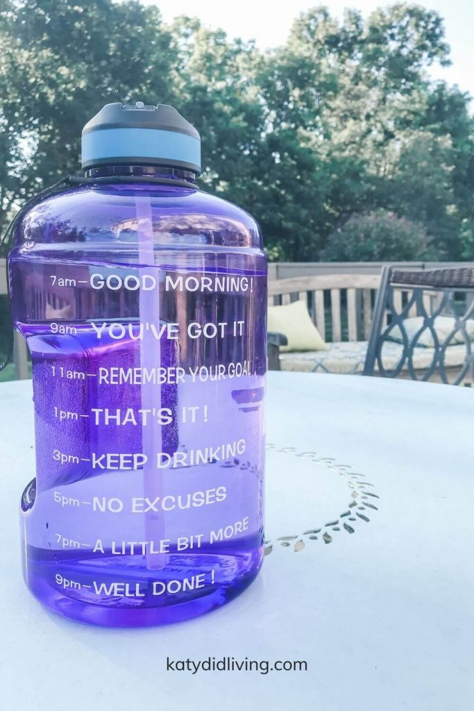 Gallon sized water bottle with time markings down one side with motivational phrases.